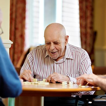Dominoes With Residents - Westward Care